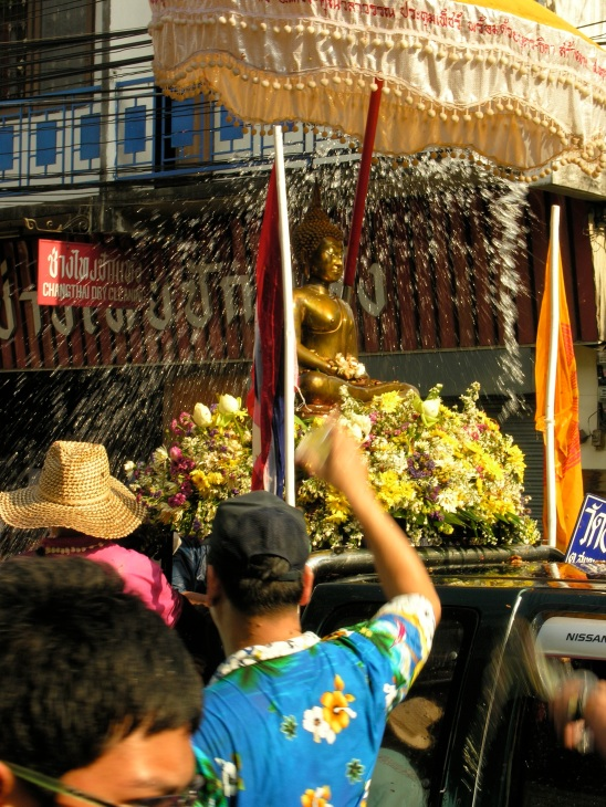 A bath for Buddha, Songkran parade, Chiang Mai, Thailand